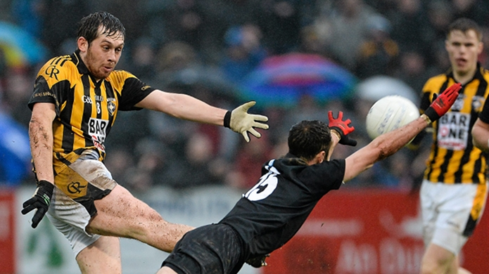 15 November 2015; Johnny Hanratty, Crossmaglen Rangers, has a shot at goal as Conor Laverty, Kilcoo, tries to block it down. AIB Ulster GAA Senior Club Football Championship, Semi-Final, Kilcoo v Crossmaglen Rangers. Páirc Esler, Newry, Co. Down. Picture credit: Oliver McVeigh / SPORTSFILE
