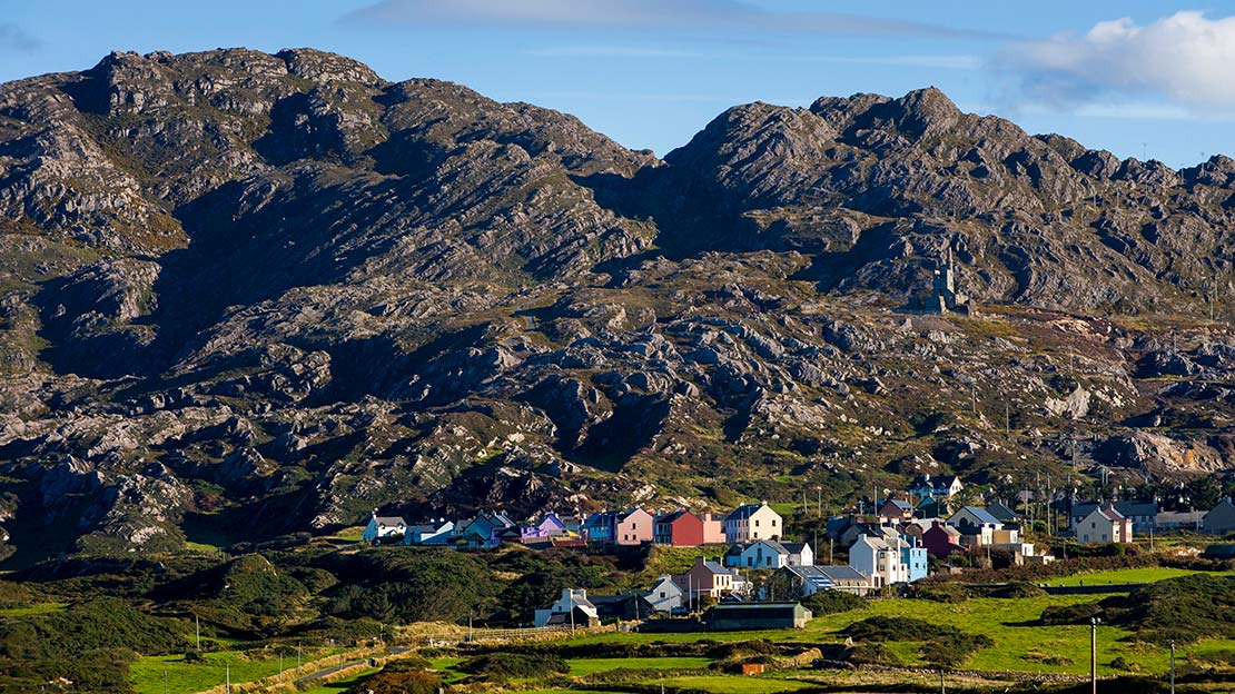 Colurful Alihies village nestled against against Mountain Ways Ireland - Walking Holidays in Ireland: 9 of The Best Routes - The Beara Way