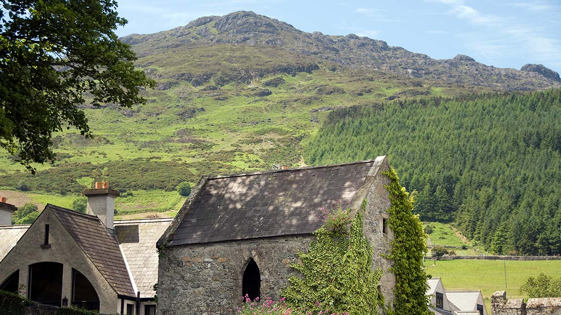 View of Slieve Foye Mountain towering above from Carlingford village Mountain Ways Ireland - Walking Holidays in Ireland: 9 of The Best Routes - The Mourne Cooley Gullion Way