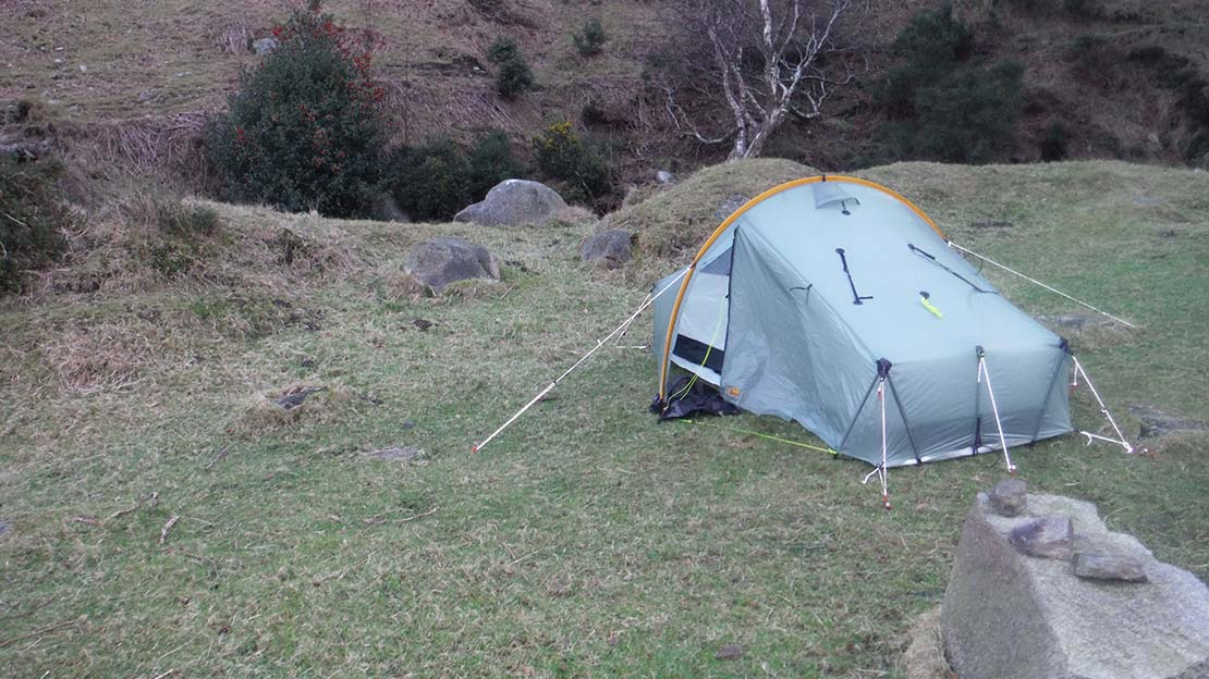 scarp tarp tent 2 pitched by a river - Leave no trace: The 7 Principles - Camping