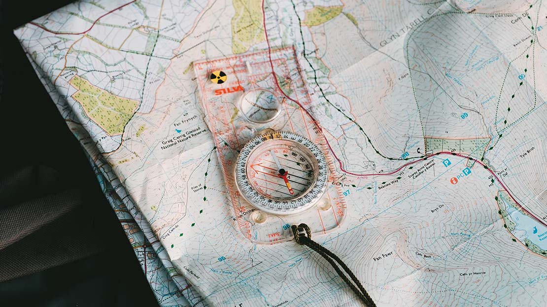 Silva compass on a paper map ,Mountain Ways Ireland - What's in my rucksack?