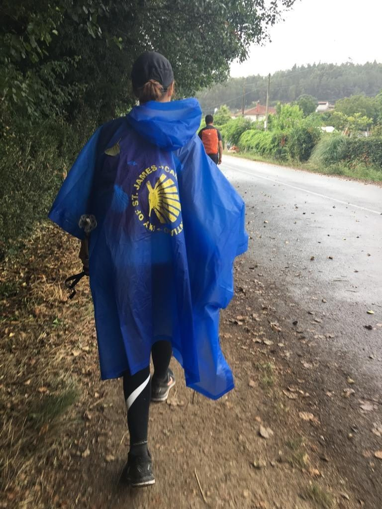 woman with blue poncho on the Camino