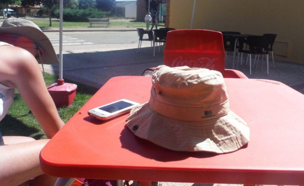 table with sunhat and iphone on the Camino
