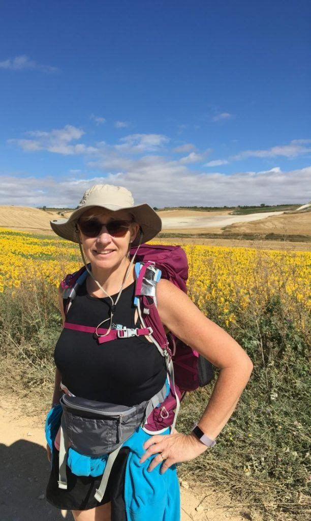 Woman in sunhat ,sunglasses and rucksack on the Camino