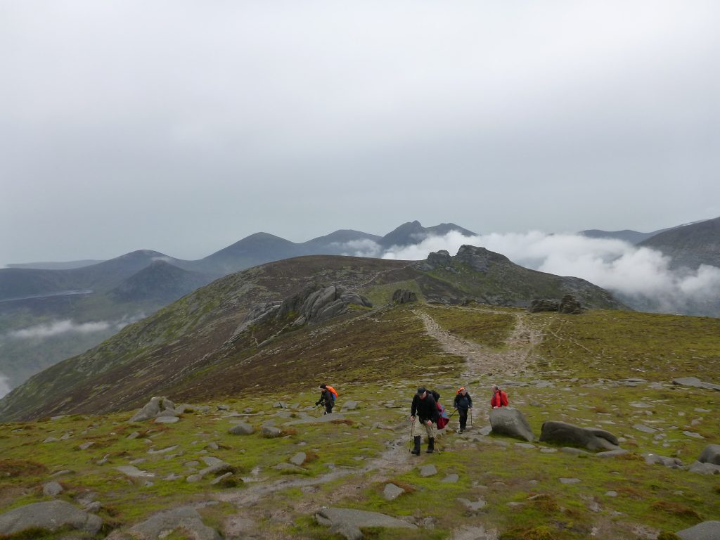 four Hikers on the mountain top trail of Slieve Binnian