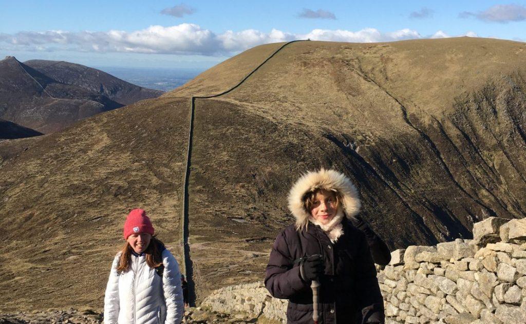 Young girl and two women climbing Slieve Donard