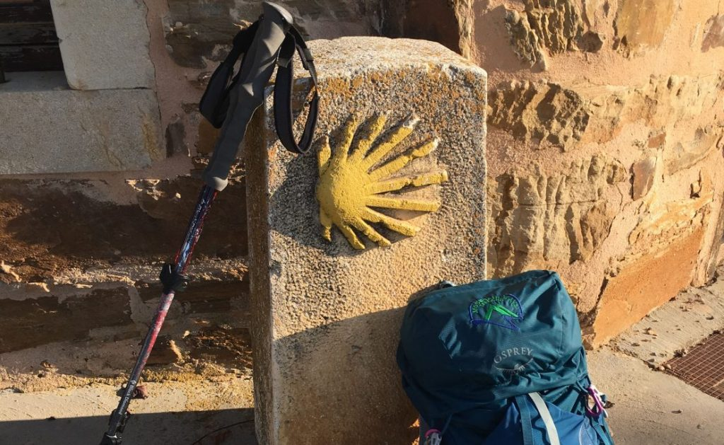 Rucksack and sticks at Camino marker