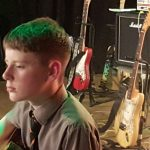 Guitarist performing at the Spring Concert