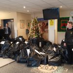 Pupils with bags at the Christmas tree