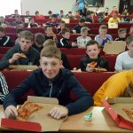 Pupils eating pizza