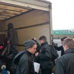 Pupils loading lorry