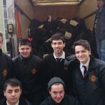 Pupils at fully-loaded lorry