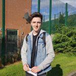 Adam O'Neill celebrates 4 A grades at AS Level