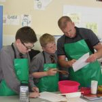 Father and sons baking at the Cupcake Event