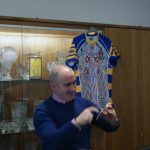 Mr Herron with the school's Australian Football top