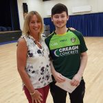 Mrs Crookes congratulates Colm McCluskey on his successful A-Level results