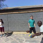 Students and kids playing basketball