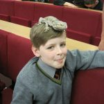 Pupil with a lizard on his head
