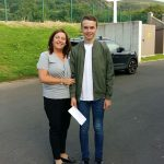 Ronan McCluskey celebrating his 10Astar and 1 A with his proud mother