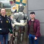 Students with a suit of armour